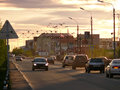 Nadym russia june the city skyline in central road with riding on her car sunset over Royalty Free Stock Photo