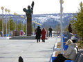 Nadym russia may the city centre town square with monument in center in strangers walking around Royalty Free Stock Photo
