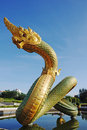 Naga on the pond with blue sky. Royalty Free Stock Photo