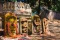 Nagas a row of hindu naga deities decorated with flowers and kumkum Stock Image