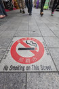 Naha japan april no smoking warning sign built pavement kokusaidori busy tourist street city naha okinawa prefecture japan smoking Royalty Free Stock Photo