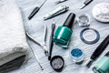 Nail artist desk with manicure set and nail polish for hands care light background Royalty Free Stock Photo