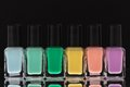 Nail polish bottles black background Royalty Free Stock Photography