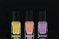 Nail polish bottles black background Stock Images