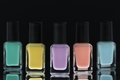 Nail polish bottles black background Stock Image