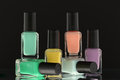 Nail polish bottles black background Royalty Free Stock Image