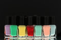 Nail polish bottles black background Royalty Free Stock Photos
