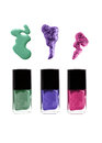 Nail polish bottles with spills green violet purple or pink colors Stock Image