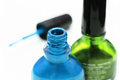Nail polish cosmetics blue and green bottles Royalty Free Stock Photos