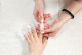 Nail polish removing with special pin equipment Royalty Free Stock Photo