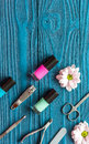 Nail polish and spa manicure set on dark wooden background Royalty Free Stock Photo