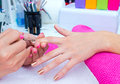 Nail polishing in manicure salon woman hand on treatment beauty Royalty Free Stock Photo