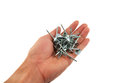 Nails tack in hand on white backgrounds Stock Image
