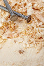 Nails and wood shavings Stock Photography
