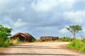 Naiopue mozambique december the settlement a reside residential building unknown african man stands near his home in Stock Images