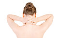 Naked beautiful woman holding her neck. Back view. Royalty Free Stock Photo