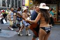 "Naked cowgirl new york ma july asking tourist for money to take a picture with her in times square a team of ""naked"" cowboys Royalty Free Stock Photos"
