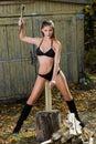 Naked woman chopping wood. lumberjack Royalty Free Stock Photo