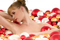 Naked woman lying in bath with Christmas balls Royalty Free Stock Photo
