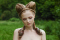 Naked young woman with fashion hairstyle and two big snails