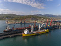 Nakhodka, Russia - May 16, 2017: Bulk carrier GNS Hore and vessel for transportation of large cargoes Happy Sky are in the port ne