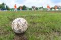 Nakhon Ratchasima, Thailand - October 1 : Muddy soccer ball on a football field in Municipal Stadium Nakhon Ratchasima on October Royalty Free Stock Photo
