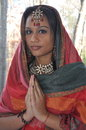 Namaste a beautiful girl with colorful jewelry and clothes Royalty Free Stock Photography