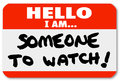 Name tag hello i am someone to watch nametag a namtag sticker with the words single out a special person or job candidate Royalty Free Stock Photo