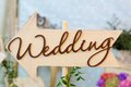 Nameboard of word wedding on brown wooden background Royalty Free Stock Photos