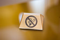 Nameplate with no smoking sign over the table. Royalty Free Stock Photo