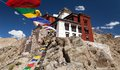 Namgyal Tsemo Gompa with prayer flags - Leh - Ladakh Stock Photos