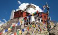 Namgyal tsemo gompa with prayer flags leh ladakh india jammu and kashmir Stock Photo