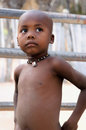 Namibian boy namibia an unidentified child with ethnic ornamental stand in his traditional village near the epupa falls Stock Photography