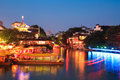 Nanjing night scene view of confucius temple with cruise boat on the beautiful qinhuai river china Royalty Free Stock Photos