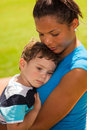 Nanny love beautiful with young boy outdoors in a park setting Stock Images