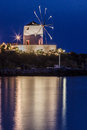 Naousa paros island greece the windmill lighten at night and iluminating the aegean sea Stock Photos