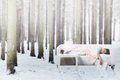 Nap in winter forest young woman having on sofa Royalty Free Stock Photos
