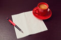 Napkin and coffee cup on desk mock up for sketch presentation over wooden surface Royalty Free Stock Photography