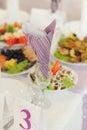Napkin in glass violet on table Stock Photo
