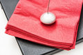 Napkin holder with paperweight and red napkins Royalty Free Stock Photo