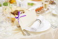 Napkin and name card empty with bow on plate Royalty Free Stock Images