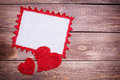 Napkin with white lace red on the wooden background Royalty Free Stock Photos