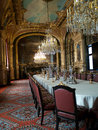 Napoleons chambers in louvre paris one of the napeoleons museum france long table chairs and chandeliers with opulent decor all Royalty Free Stock Photo