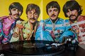 Turntables with the Beatles vinyls in the background. Royalty Free Stock Photo
