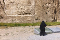 Naqsh e rustam bas relief iran woman wearing a chador looking at a in rusta an ancient necropolis located about km northwest of Royalty Free Stock Images