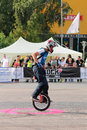 Narcis roca tricks with the monocycle doing at iubim roti we love two wheels event in romania at romexpo at this event it was Stock Image