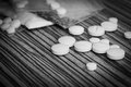 Narcotic recreational drugs pills on wooden table Royalty Free Stock Photos