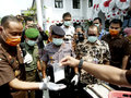 Narcotics security officers destroy evidence of in the city of solo central java indonesia Royalty Free Stock Images