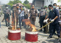 Narcotics security officers destroy evidence of in the city of solo central java indonesia Royalty Free Stock Photo