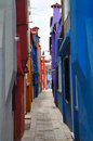 Narrow alley on the Burano island Royalty Free Stock Image